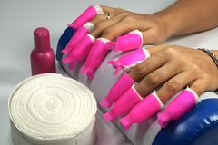 Intensely pink clips for the removal of nail acrylic, glitters,. Hybrid, gel and nail polish royalty free stock image