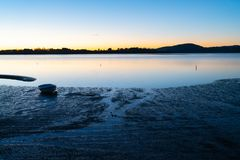 Intensity of Tauranga sunrise across harbor Stock Photo
