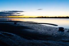 Intensity of Tauranga sunrise across harbor as light of sky and Royalty Free Stock Photo