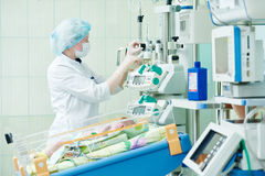 Intensive care unit female doctor with baby infant Stock Images