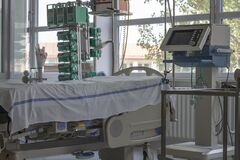 Intensive care unit in hospital, bed with monitor, ventilator, a place where can be  treated patients with pneumonia caused by