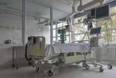 Intensive care unit in hospital, bed with monitors, ventilator, a place where can be  treated patients with pneumonia caused by