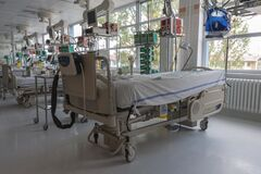Intensive care unit in hospital, beds with monitors an ventilators, a place where they are treated patients with pneumonia caused