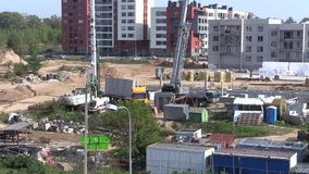 Intensive construction site works. Workers and heavy machinery. stock footage