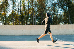 Intensive workout of professional runner Stock Photos