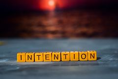 Intention on wooden blocks. Cross processed image with bokeh background stock photography