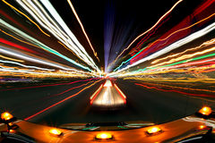 Intentional Blur Image of Driving at Night With Ci. Abstract Image of Driving at Night With City Lights and Traffic Royalty Free Stock Photos