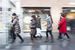Intentional blurred image of people in shopping center. People Walking, intentional blurred image of people in shopping center Royalty Free Stock Photography