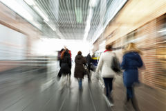 Intentional blurred image of people in shopping center. People walking, intentional blurred image of people in shopping center Stock Image