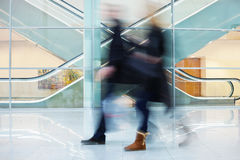 Intentional Blurred Image of Two Businesspeople in Office Buildi Royalty Free Stock Image