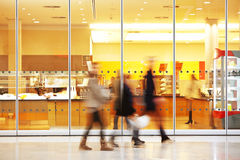 Intentional Blurred Image of Young People in Shopping Center Royalty Free Stock Photos