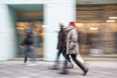 Intentional Blurred Image of Young People in Shopping Center Stock Photo