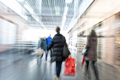 Intentional Blurred Image of Young People in Shopping Center. People walking in shopping center Royalty Free Stock Image