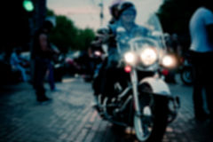 Intentionally Blurred Background. Couple of Bikers on Evening. City Road Sidewalks. Humans Not Recognizable. Image May Be Used in Article About Biker Club Royalty Free Stock Photos