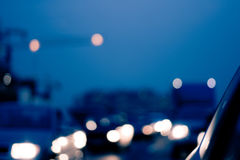 Intentionally Blurred Background. Heavy Traffic on Evening Road. Bokeh. Car Headlights on Congested City Highway at Dusk. Image May Be Used in Article About Royalty Free Stock Images