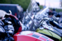 Intentionally Blurred Background. Motorcycles Parked in a Row. Image May Be Used in Article About Biker Club Meeting in Metropolis Stock Photo