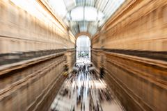 Intentionally motion blurred creative image of people and commuters walking in Galleria Vittorio Emanuele II in Milan, Italy. Intentionally motion blurred stock image