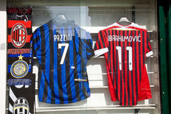 Inter and AC Milan. Milan, Italy - February 23, 2012: Shirts of rivaling football clubs Inter Milan and AC Milan in a shop window, Milan Stock Photo