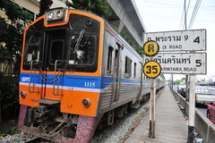 Inter City Train. An SRT inter city train runs on tracks through the city centre on May 27, 2013 in Bangkok, Thailand. The State Railway of Thailand (SRT) runs Royalty Free Stock Photography