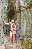 Inter ethnic couple of tourists in Angkor Wat complex Royalty Free Stock Photography