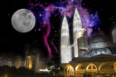 Inter-Galactic City Skyline at Night. Image of Kuala Lumpur skyline against a background of stars, the moon and galaxies Stock Images