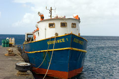 An inter-island cargo ship at kingstown harbor Stock Images