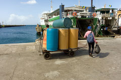 Inter-island ferries loading supplies and passengers Stock Photo