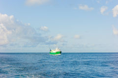 An inter-island ferry plowing the bequia channel Stock Image