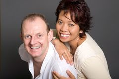 Inter-marriage couple of Asian woman and European. Happy inter-marriage couple of Asian woman and European man Stock Images