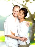 Inter-married couple of Asian and Caucasian. Happy inter-married couple of Asian and Caucasian background Royalty Free Stock Photos
