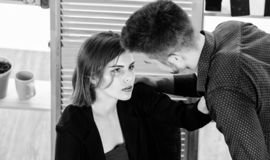 Inter office relationship. Workplace affair. Workplace romance of handsome man and sexy woman in office. Couple in love stock photos
