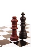 Inter-racial marriage. King and Queen of opposite colours on the chessboard Stock Images