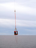 Inter Rig Transfer Using Basket Lift from Supply or Crew Boat Royalty Free Stock Images