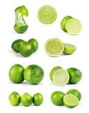 Intera frutta e fette della calce isolate su fondo bianco con Cl Fotografie Stock Libere da Diritti