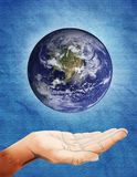 Interact with earth. A hand is interacting with the world in spiritual way Stock Photo