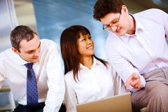 Interacting co-workers Royalty Free Stock Images