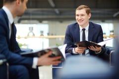 Interacting at meeting Stock Image