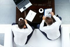 Interacting men Stock Photography