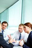 Interacting in office Stock Photo