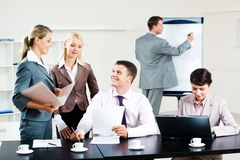 Interaction. Image of business group discussing new project during break in the office Stock Images