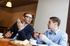 Interaction of businessmen Stock Photos