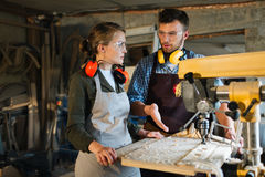 Interaction of woodworkers Stock Photo