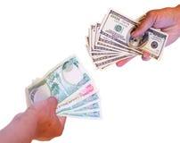 Intercambio de dinero en circulación imagen de archivo