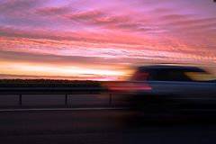 Interchange of the highway. Dramatic sky, fiery sunset. royalty free stock image