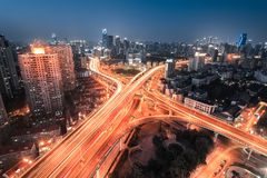 Interchange overpass at night. Light trails on the city highway junction in shanghai Royalty Free Stock Images