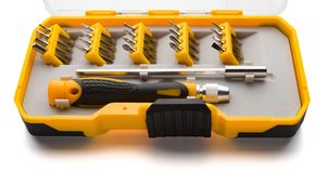 Interchangeable screwdriver set with different types of metal steel heads and bits with clipping-path. Interchangeable screwdriver set with different types of Stock Photo
