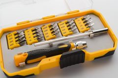 Interchangeable screwdriver set with different types of metal steel heads & bits Royalty Free Stock Photo