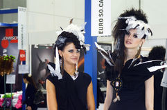 Intercharm XXI International Perfumery and Cosmetics Exhibition Two young beautiful womans in black dress stock photos
