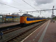 Intercity arriving at Rotterdam Central Station Royalty Free Stock Photography