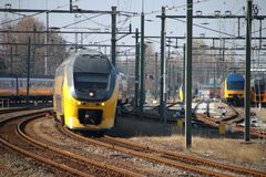 Intercity double decker arriving at the central station of Rotterdam in the Netherlands.  Stock Photos